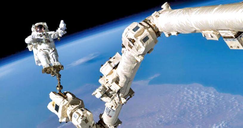 ■太空人和加拿大臂。網上圖片