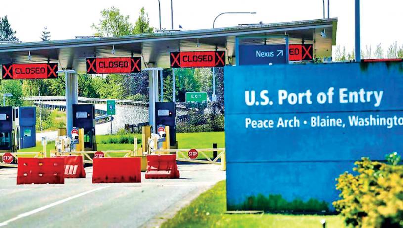 ■美國暫時拒絕向加拿大陸路開放邊境。 資料圖片