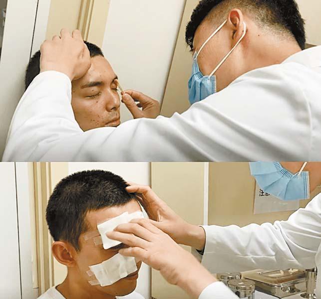 吳磊受傷後醫生為其 治療。 網上圖片